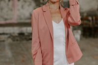 27 a plain silk slip wedding dress, a pink blazer and a hat for a creative yet casual bridal look with a touch of color