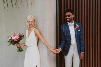 28 a simple and cool white midi wedding dress with a deep neckline, thick straps, a side slit, pink ankle strap shoes is wow