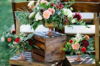 30 bold floral arrangements of blush, red, burgundy blooms and greenery of various types is a lovely idea for a boho wedding