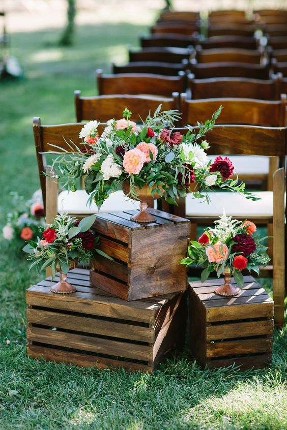 bold floral arrangements of blush, red, burgundy blooms and greenery of various types is a lovely idea for a boho wedding