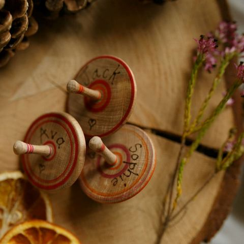 traditional wooden spinning tops made from a solid piece of recycled beechwood and are handcrafted are great