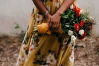 31 a yellow floral A-line maxi dress, a red necklace with a tassel and strappy sandals for a chic and relaxed summer bridal look