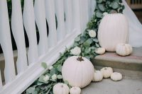 31 style your stairs with white pumpkins and eucalyptus to give the location and more wedding-like look