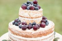 36 a naked wedding cake topped with fresh sugared berries is a lovely idea for a simple backyard wedding in the fall
