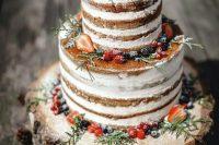 37 a naked wedding cake with greenery and fresh berries and sugar is a lovely idea for a backyard fall or winter wedding