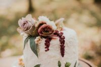38 a simple and textural wedding cake with dusty pink and lilac blooms, greenery, berries and seed pods is a cool idea for the fall
