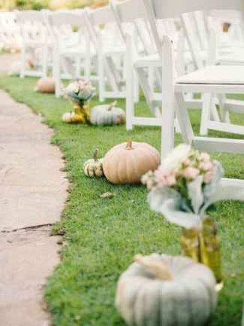 pumpkins are perfect to decorate a fall wedding's ceremony space