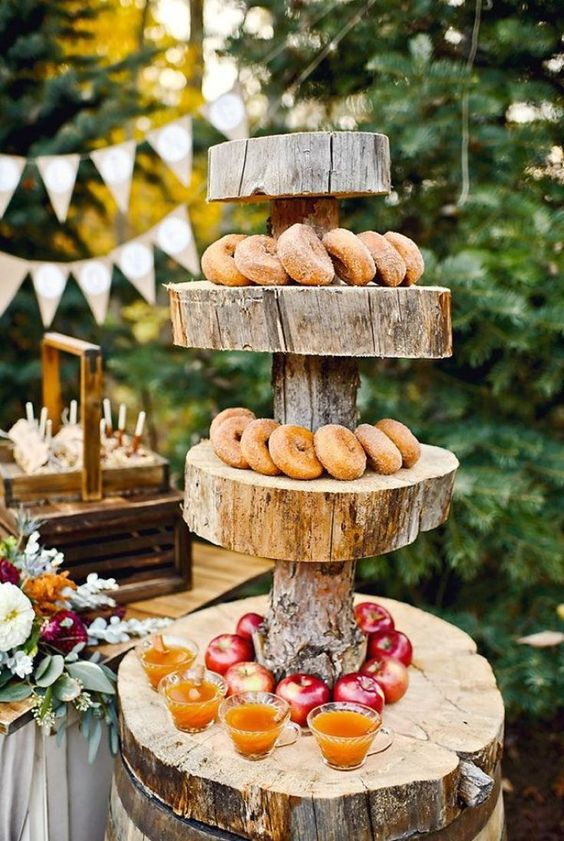 pretty wedding appetizer serving with a thick slice stand, apples, donuts and cider is a lovely idea for a cozy and homey wedding