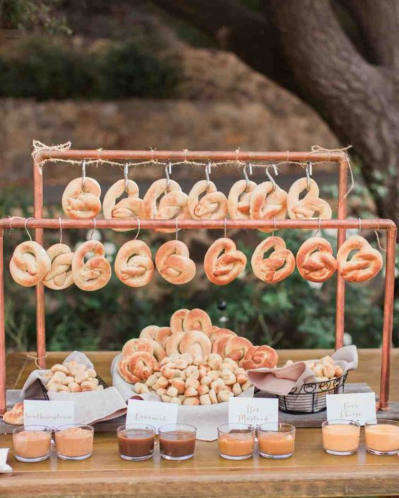 a cool pretzel bar with lots of buns, pretzels and delicious sauces is a very nice and comforting fall wedding food station