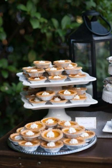 mini pumpkin pies with whipped cream are delicious for a rustic fall wedding and are very comforting and cool