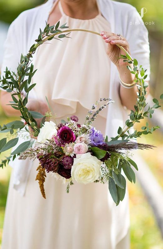 a beautiful hoop wedding bouquet with much greenery, white and bold blooms and lavender is a cool idea for a boho bride