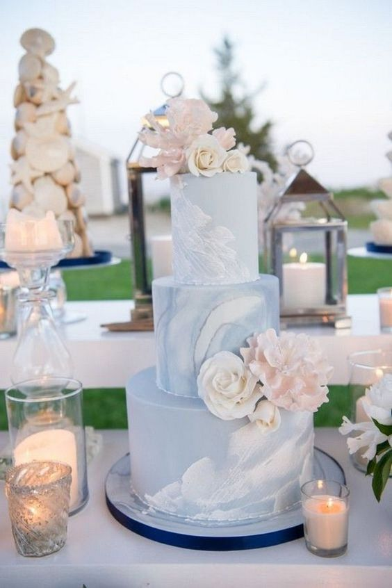 a blue marble wedding cake topped with blush and white blooms is a great and chic idea for a pink and blue wedding