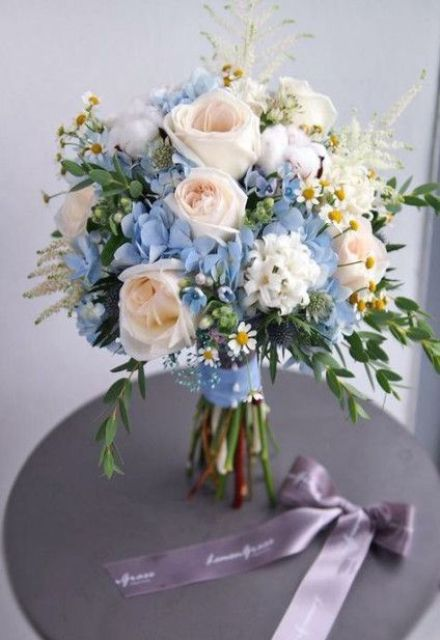 a blush and blue wedding bouquet with roses, hydrangeas, daisies, greenery and other stuff is a very lovely idea