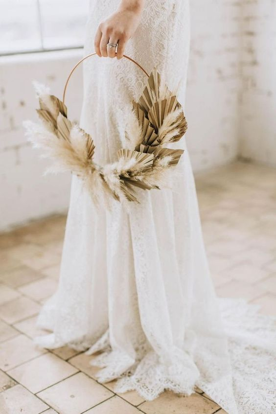 a boho hoop wedding bouquet with dried fronds and pampas grass is a chic idea for a summer or fall wedding