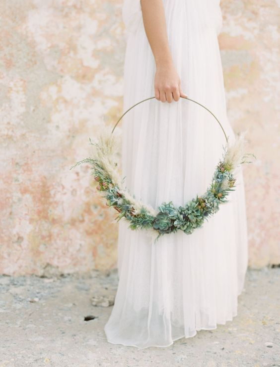 a boho hoop wedding bouquet with greenery, thistles, succulents and pampas grass is a stylish idea for a modern boho bride