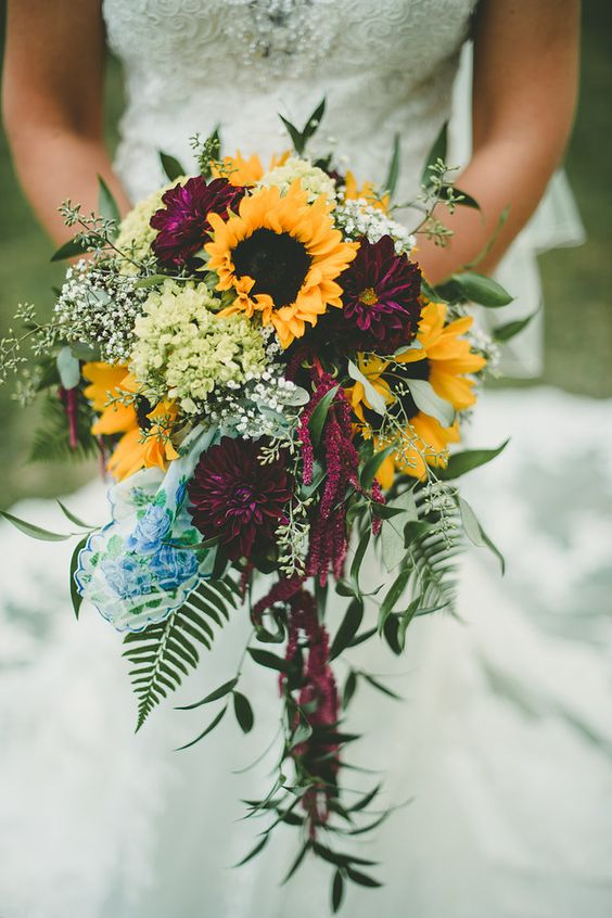 a cute fall wedding bouquet with yellow touches
