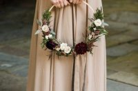 a bold hoop wedding bouquet of greenery of various kinds, astilbe, white and burgundy blooms is a chic idea for a fall wedding