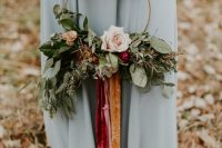 a bold hoop wedding bouquet with lush greenery, pastel blooms and bold ribbons of velvet is a chic and pretty idea for a bridesmaid