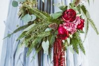 a bright and bold hoop wedding bouquet with eucalyptus, fern and bold deep red and pink blooms is a cool solution for summer or fall