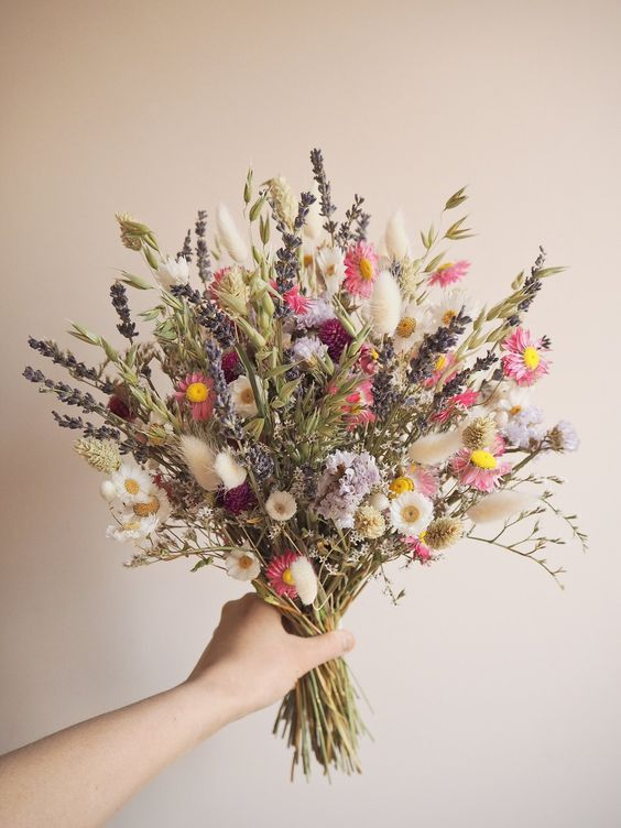 a bright dried and natural flower wedding bouquet with daisies, astilbe, lavender, grass, twigs is a fun idea for a summer boho bride