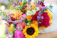a bright summer wedding bouquet with sunflowers