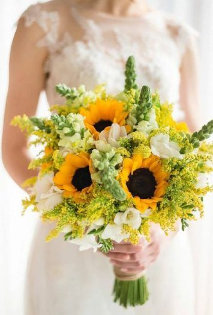 a bright wedding bouquet of sunflowers, white blooms and mimosas is an amazing idea for a colorful summer wedding