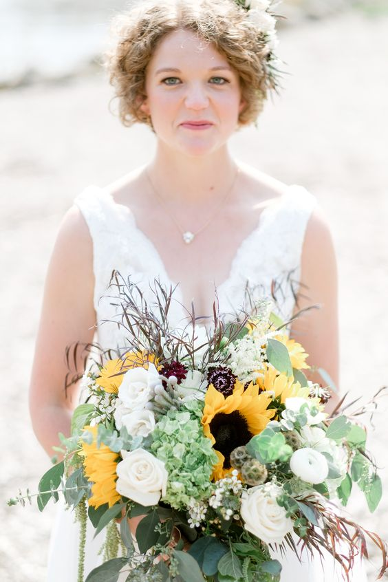 a chic wedding bouquet with sunflowers, succulents, white and deep purple blooms, greenery is a lovely idea for every bride