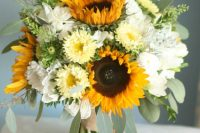a colorful and chic wedding bouquet of sunflowers, white and yellow blooms and greenery is a lovely idea for a summer bride