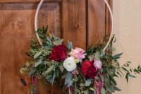 a colorful hoop wedding bouquet with lush eucalyptus, pink, deep red and white blooms and lisianthus is a bold solution for summer or dall