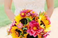 a colorful rustic chic wedding bouquet with pink blooms, greenery and sunflowers is a cool idea to rock for any rustic wedding