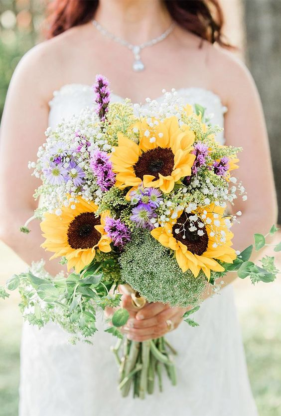 a colorful wedding bouquet with sunflowers, purple blooms, greenery, baby's breath is a lovely idea for a rustic summer bride