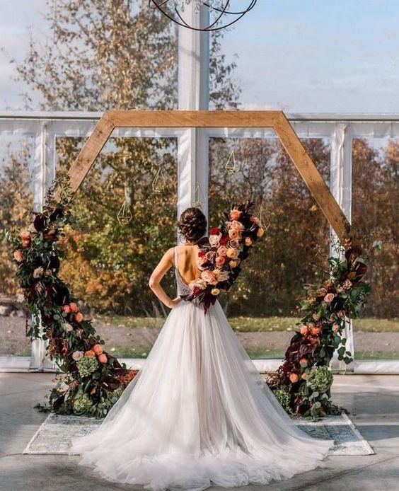 a simple hexagon wedding arch suitable for a fall wedding