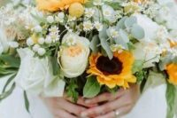 a delicate wedding bouquet of peachy and white blooms, sunflowers, berries, daisies, greenery is a lovely idea for spring