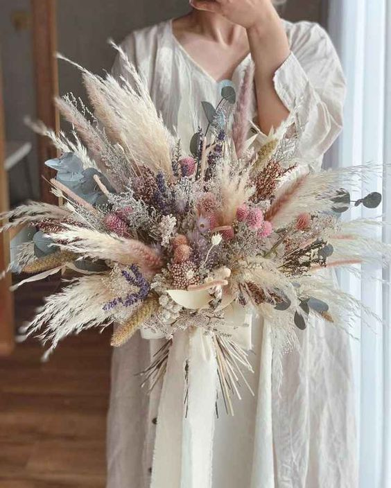 a dreamy dried flower wedding bouquet with pampas grass, lavender, allium, eucalyptus and some dried grasses is a lovely idea for spring or summer