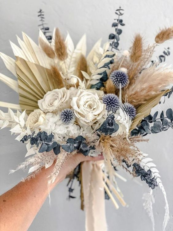 a dreamy wedding bouquet with dried fronds, blue eucalyptus, allium, bunny tails, roses and grasses is a amazing for spring or summer