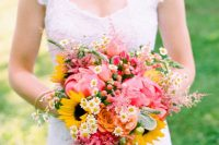 a fun and colorful summer wedding bouquet of pink peonies, daisies, sunflowers, some fillers like astilbe is a lovely idea for summer