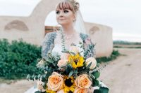 a gorgeous modern wedding bouquet of large peachy roses, sunflowers and eucalyptus is an amazing idea for a summer bride