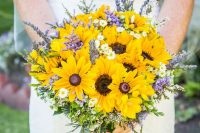 a laid-back rustic wedding bouquet of sunflowers, lavender, daisies and greenery plus evergreens is easy to make yourself