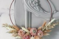 a lovely hoop dried flower wreath with wheat and pink blooms looks very delicate and chic, and will match rustic or boho style