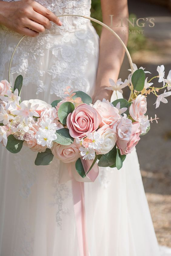 a lovely hoop wedding bouquet of white and blush blooms, greenery is a chic idea for a romantic bride or bridesmaid