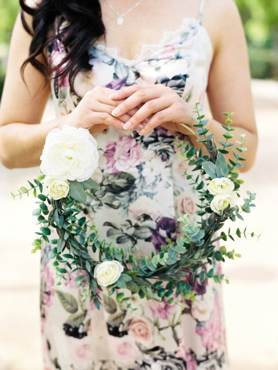 a lovely hoop wedding bouquet with white blooms and eucalyptus is a cool idea for a spring or summer wedding