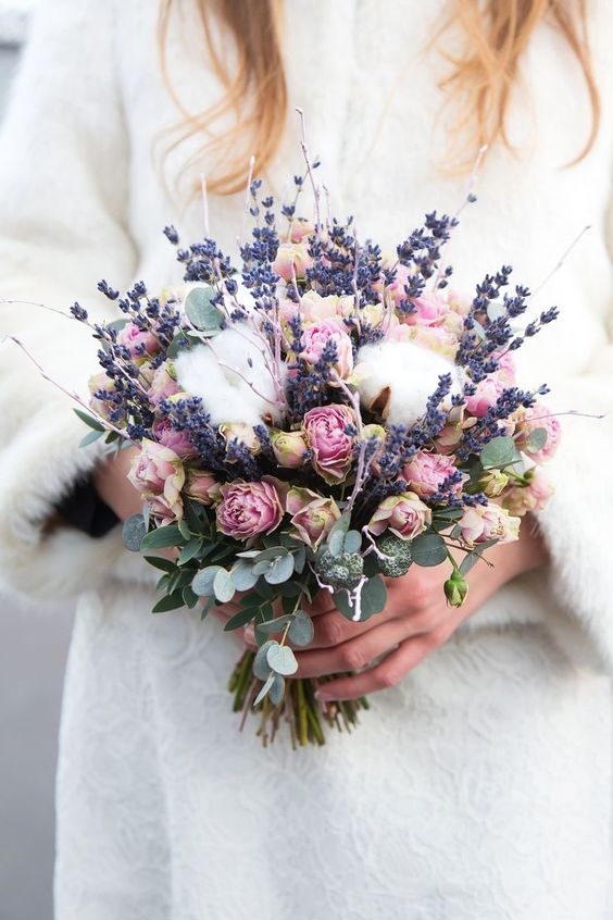 a lovely wedding bouquet of lavender, cotton, pink roses, twigs and eucalyptus is a pretty solution for a summer wedding