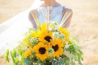 a lush rustic wedding bouquet of sunflowers, wheat, baby's breath and various types of greenery is a wow solution