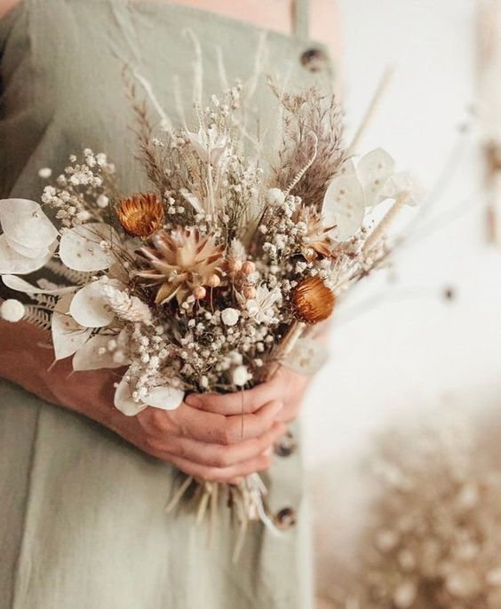 a pretty dried wedding bouquet of lunaria, pampas grass, baby's breath, dried daises and fern is a lovely idea for both a bride or bridesmaid