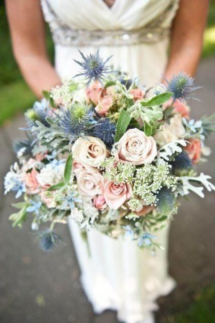 a pretty wedding bouquet of pink roses, thistles, greenery and pale leaves is a chic idea for a spring or summer bride