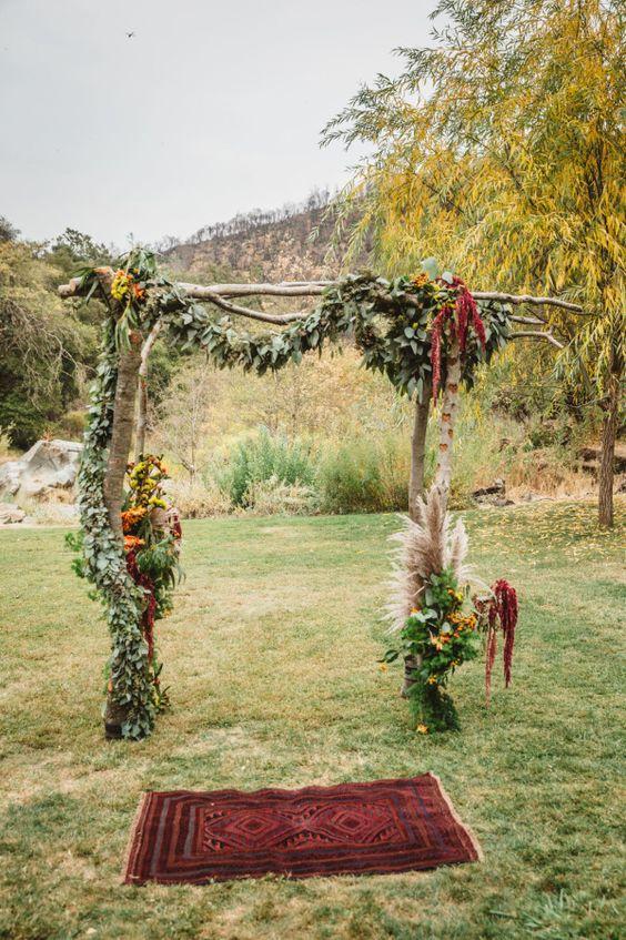 a boho wedding arch for a fall wedding
