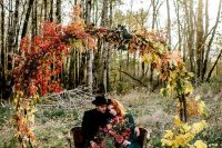 a cool fall wedding arch with fall-colored blooms