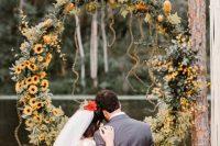 a cute fall round wedding arch