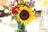 a simple yet cute centerpiece with sunflowers