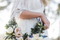 a stylish hoop wedding bouquet of greenery, white, pink and blue flowers is a very cool idea for a boho bride